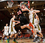RAPID CITY, S.D.-- MARCH 21, 2015:  Landon Hoellein #34 of Aberdeen Roncalli blocks an outlet pass from Riley Schmidt #22 of Dell Rapids during their game at the 2015 South Dakota  State A Boys Basketball Tournament at the Don Barnett Arena in Rapid City Saturday. (Photo by Dick Carlson/Inertia)