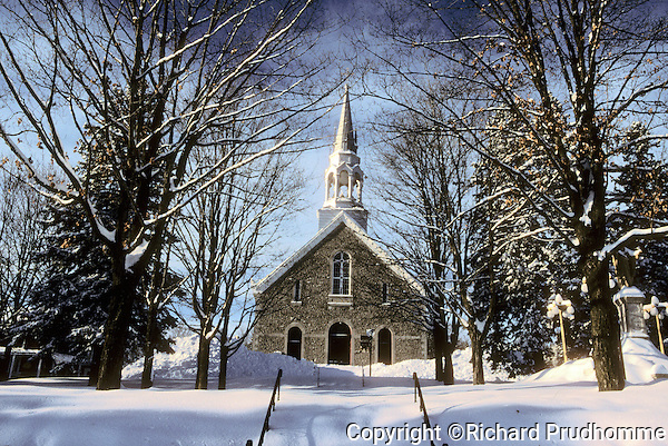 Old stone French  Catholic church in Saint-Jean-de-Matha, quebec in winter