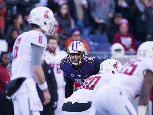Travis Feeney prepares to rush the quarterback.