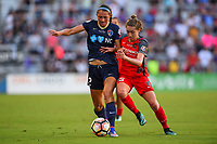 Orlando, FL - Saturday October 14, 2017: Ashley Hatch, Meghan Klingenberg during the NWSL Championship match between the North Carolina Courage and the Portland Thorns FC at Orlando City Stadium.