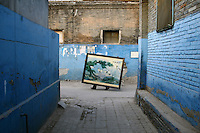CHINA. Beijing. Family moving possesions prior to their home and 'hutong' being destroyed to make way for new developments aimed at modernising the city for the 2008 Summer Olympics. 2005