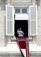 Papa Francesco recita l'Angelus domenicale affacciato su piazza San Pietro dalla finestra del suo studio. Citta' del Vaticano, luglio7, 2019.<br /> Pope Francis recites the Sunday Angelus noon prayer from the window of his studio overlooking Saint Peter's Square, at the Vatican, on July 7, 2019.<br /> UPDATE IMAGES PRESS/Isabella Bonotto<br /> <br /> STRICTLY ONLY FOR EDITORIAL USE