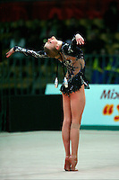 "Olga Kapranova of Russia begins routine with clubs at 2008 World Cup Kiev, ""Deriugina Cup"" in Kiev, Ukraine on March 22, 2008."