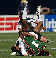 February 14 2009, San Diego, CA, USA:  The IRB USA Sevens Tournament at Petco Park in Downtown San Diego.  A Mexico player is tackled by a Fiji player during day one action.