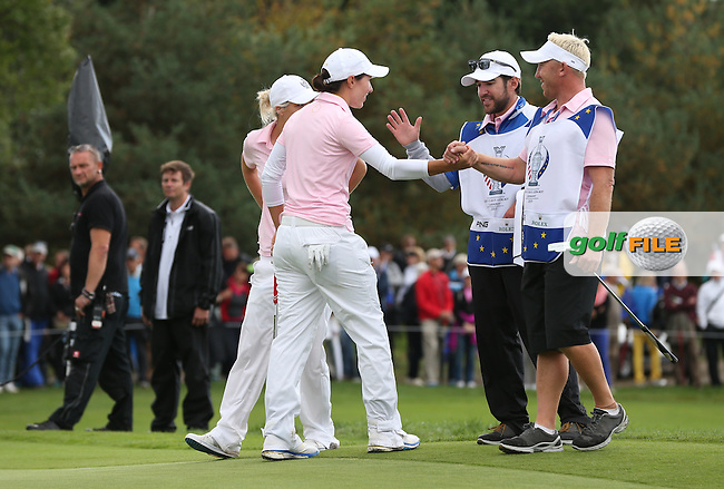 Carlota Ciganda (ESP) and Melissa Reid (ENG) begin to celebrate their win on the 15th with their caddies during Saturday morning's Foursomes, at The Solheim Cup 2015 played at Golf Club St. Leon-Rot, Mannheim, Germany.  19/09/2015. Picture: Golffile | David Lloyd<br /> <br /> All photos usage must carry mandatory copyright credit (&copy; Golffile | David Lloyd)