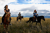 "Rowan, a five-year-old autistic child, riding a horse, accompanied by his parents, Kristin Neff and Rupert Issacson, and their guide, Tulga, during a horseback expedition across Mongolia. Rowan, who has been nicknamed ""The Horse Boy"", embarked on a therapeutic journey of discovery with his parents to visit a succession of shaman healers in one of the most remote regions in the world. Following Rowan's positive response to a neighbour's horse, Betsy, and some reaction to treatment by healers, Rowan's parents hoped that the Mongolian shamanistic rituals along the route and the prolonged contact with horses would help to unlock their son's autism and assist his development.."