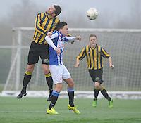 VOETBAL: HEERENVEEN: 23-11-2014, Sportpark Skoatterwâld, VV Heerenveen - Frisia, uitslag 2 - 0, Dennis Schotanus (#15) Remco Hof, (#4), ©foto Martin de Jong