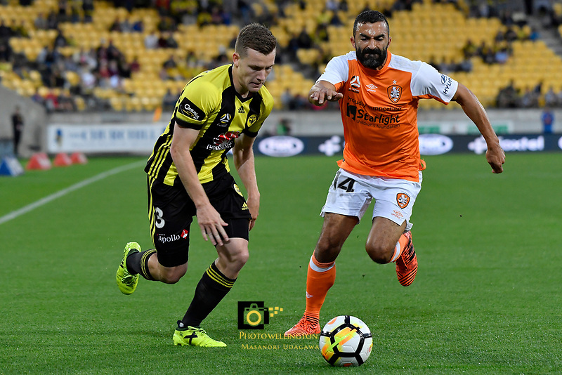 Wellington Phoenix&rsquo; Scott Galloway and Brisbane&rsquo;s Fahid Ben Khalfallah in action during the A League - Wellington Phoenix v Brisbane Roar FC at Westpac Stadium, Wellington, New Zealand on Saturday 28 October.<br /> Photo by Masanori Udagawa. <br /> www.photowellington.photoshelter.com