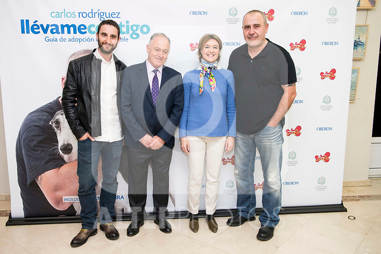 """Dani Rovira, Felipe Villas, Minister for Agriculture and Fisheries, Food and Environment, Isabel García Tejerina and Carlos Rodriguez during the presentation of the book """"Llevame contigo"""" of Carlos Rodriguez in Madrid, Spain. March 15, 2017. (ALTERPHOTOS/BorjaB.Hojas)"""