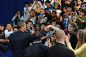 Arlington, VA - September 8, 2009 -- United States President Barack Obama (L) shakes hands with students after delivering a national address directed to students across the nation, at a back to school event at Wakefield High School in Arlington, Virginia, USA, 08 September 2009.  President Obama delivered remarks to encourage students to study hard, stay in school and take responsibility for their own education on the first day of the school year for many children across America.  .Credit: Michael Reynolds - Pool via CNP