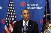 United States President Barack Obama pauses as he addresses members of the Business Roundtable September 18, 2013 at the Business Roundtable Headquarters in Washington, DC. Obama spoke on various topics including the national debt ceiling and immigration reform, and then answered questions from the members after his address. <br /> Credit: Alex Wong / Pool via CNP