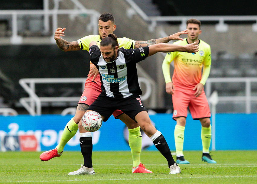 Newcastle United's Andy Carroll holds off the challenge from Manchester City's Nicolas Otamendi <br /> <br /> Photographer Alex Dodd/CameraSport<br /> <br /> FA Cup Quarter-Final - Newcastle United v Manchester City - Sunday 28th June 2020 - St James' Park - Newcastle<br />  <br /> World Copyright © 2020 CameraSport. All rights reserved. 43 Linden Ave. Countesthorpe. Leicester. England. LE8 5PG - Tel: +44 (0) 116 277 4147 - admin@camerasport.com - www.camerasport.com