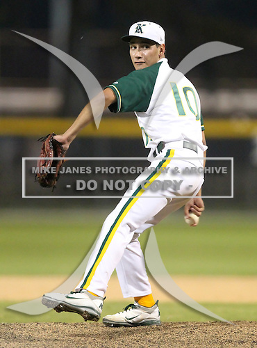 Pitcher Gabriel Llanes (10) of the Miami Killian Cougars varsity baseball team delivers a pitch against the Barron Collier Cougars during the Sarasota Classic Tournament at Buck O'Neil Complex in Sarasota, Florida;  March 14, 2011.  (Copyright Mike Janes Photography)
