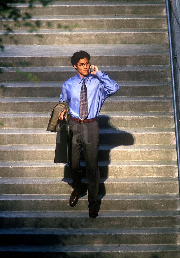 Asian American businessman on the go.