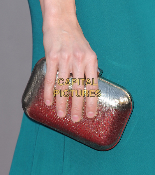"""Heather Graham's hand.""""The Hangover Part III"""" Los Angeles Premiere held at the Westwood Village Theater, Los Angeles, California, USA..May 20th, 2013.green silver clutch bag detail.CAP/DVS.©DVS/Capital Pictures"""