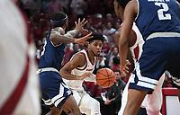 NWA Democrat-Gazette/J.T. WAMPLER Arkansas' Isaiah Joe drives to the basket against Rice's Ako Adams (3) Monday Nov. 5, 2019 during the Razorbacks' regular season opener at Bud Walton Arena in Fayetteville.