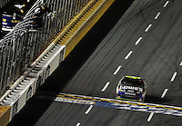 Oct. 17, 2009; Concord, NC, USA; NASCAR Sprint Cup Series driver Jimmie Johnson (48) takes the checkered flag to win the NASCAR Banking 500 at Lowes Motor Speedway. Mandatory Credit: Mark J. Rebilas-