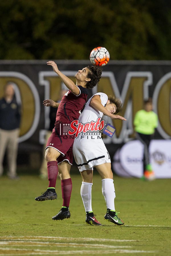 Ryan Arambula (3) of the South Carolina Gamecocks battles for a jump ball with Ian Harkes (16) of the Wake Forest Demon Deacons at Spry Soccer Stadium on October 6, 2015 in Winston-Salem, North Carolina.  The Demon Deacons defeated the Gamecocks 2-0.  (Brian Westerholt/Sports On Film)