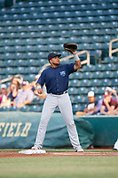 Mobile BayBears first baseman Jhoan Urena (14) stretches for a throw during a Southern League game against the Jacksonville Jumbo Shrimp on May 28, 2019 at Baseball Grounds of Jacksonville in Jacksonville, Florida.  Mobile defeated Jacksonville 2-1.  (Mike Janes/Four Seam Images)