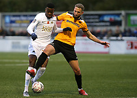 Luke Pennell of Maidstone United tackles Kalvin Lumbombo-Kalala of Torquay United during Maidstone United vs Torquay United, Emirates FA Cup Football at the Gallagher Stadium on 9th November 2019