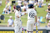 1st December 2019, Hamilton, New Zealand;  Rory Burns and Joe Root celebrate their 50 run partnership. International test match cricket, New Zealand versus England at Seddon Park, Hamilton, New Zealand. Sunday 1 December 2019.