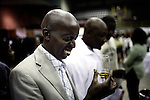 SOWETO, SOUTH AFRICA SEPTEMBER 2: Charlie Vusi Kunene, age 41, tries a brandy during a yearly Vine and Brandy festival on September 2, 2006 in Soweto, Johannesburg, South Africa. Many of the country&rsquo;s vine makers came to Soweto to introduce the newly economically empowered people about vine. Traditionally, most people drink beer and whiskey and the vine makers are targeting a new black elite that have money to spend. Soweto is South Africa&rsquo;s largest township and it was founded about one hundred years to make housing available for black people south west of downtown Johannesburg. The estimated population is between 2-3 million. Many key events during the Apartheid struggle unfolded here, and the most known is the student uprisings in June 1976, where thousands of students took to the streets to protest after being forced to study the Afrikaans language at school. Soweto today is a mix of old housing and newly constructed townhouses. A new hungry black middle-class is growing steadily. Many residents work in Johannesburg but the last years many shopping malls have been built, and people are starting to spend their money in Soweto.  <br /> (Photo by Per-Anders Pettersson)