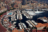 Aerial view of Port of Monaco, Monte Carlo, Monaco. with yachts, luxury boats, cruise ships, and buildings
