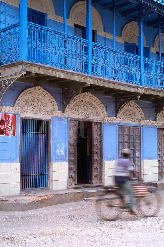 Tanzania Zanzibar Man on bicycle in Stone Town