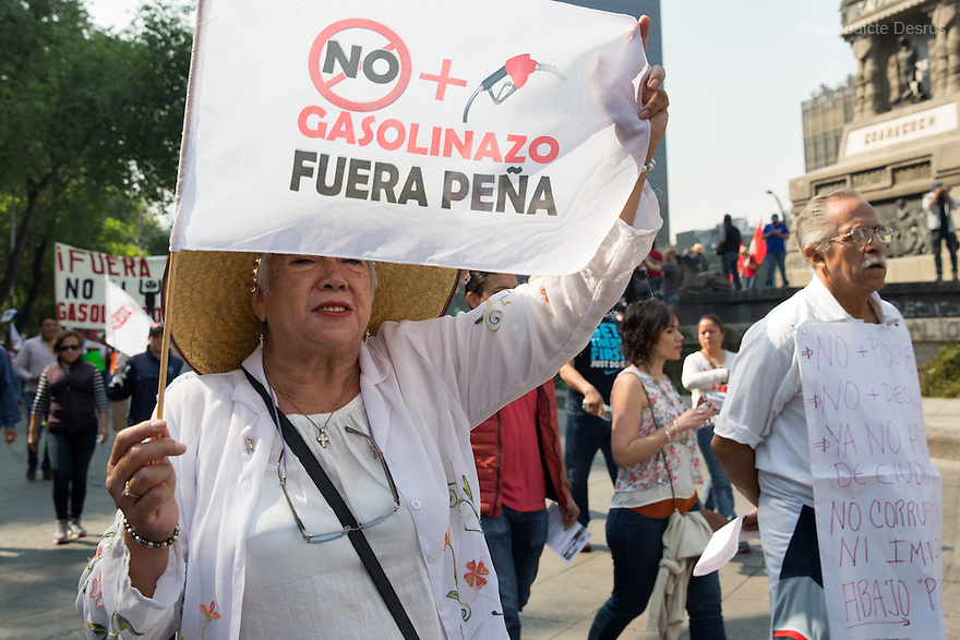 Thousands of demonstrators march to protest a sudden 20 percent fuel price hike imposed by the Mexican government in Mexico City, Mexico on January 7, 2017. Thegasolinazo– as the price hike is known – took effect on January 1. The Mexican central bank has warned that gas price increaseswould likely contribute to inflationat a time when the peso has alreadyweakened significantlyagainst the US dollar. Photo by Bénédicte Desrus