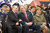 United States President George W. Bush and President Vladimir Putin of Russia share a  light moment as they sit with Laura Bush and other heads of state during a military procession commemorating the 60th anniversary of the end of World War II in Red Square, Moscow, Russia, Monday, May 9, 2005. .Mandatory Credit: Eric Draper / White House via CNP
