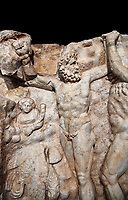 Detail of a Roman Sebasteion relief sculpture of Zeus and Prometheus, Aphrodisias Museum, Aphrodisias, Turkey.    Against a black background.<br /> <br /> Prometheus is screaming in pain. Zeus had given him a terrible punishment for giving fire to man: he was tied to the Caucasus mountains and had his liver picked out daily by an eagle. Herakles shot the eagle and is undoing the first manacle. He wears his trade mark lion-skin and thrown his club to one side. A small mountain nymph, holding a throwing stick appears amongst the rocks.