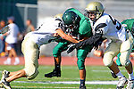 Torrance, CA 10/06/11 - unidentified South Torrance player(s), Michael Ishibashi (Peninsula #59) and Andrew Phillips (Peninsula #11) in action during the Peninsula vs South Torrance Frosh football game.