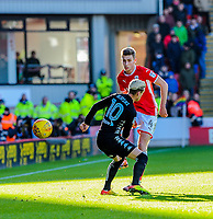 Barnsley's midfielder Joe Williams (4) plays it down thr line during the Sky Bet Championship match between Barnsley and Leeds United at Oakwell, Barnsley, England on 25 November 2017. Photo by Stephen Buckley / PRiME Media Images.