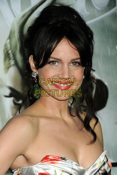 "CARLA GUGINO.""Sucker Punch"" Los Angeles Premiere held at Grauman's Chinese Theatre, Hollywood, California, USA..March 23rd, 2011.headshot portrait strapless white red  rose floral flower make-up lipstick smiling earrings dangly .CAP/ADM/BP.©Byron Purvis/AdMedia/Capital Pictures."