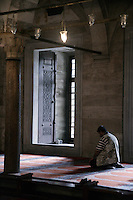 Worshiper praying at the Suleymaniye Mosque, Istanbul, Turkey