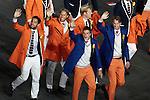 Engeland, London, 27 juli 2012.Olympische Spelen London.De openingsceremonie van de Olympische Spelen in London 2012.De Hockey heren zwaaien naar het publiek tijdens hun ere ronde