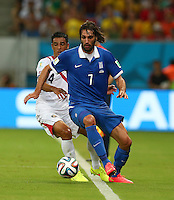 Michael Umana of Costa Rica and Georgios Samaras of Greece in action