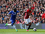 Ngolo Kante of Chelsea in action with Ashley Young of Manchester United during the English Premier League match at Old Trafford Stadium, Manchester. Picture date: April 16th 2017. Pic credit should read: Simon Bellis/Sportimage