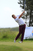 Declan Reidy (Co. Sligo) on the 1st tee during Round 1 of the Irish Amateur Close Championship at Seapoint Golf Club on Saturday 7th June 2014.<br /> Picture:  Thos Caffrey / www.golffile.ie