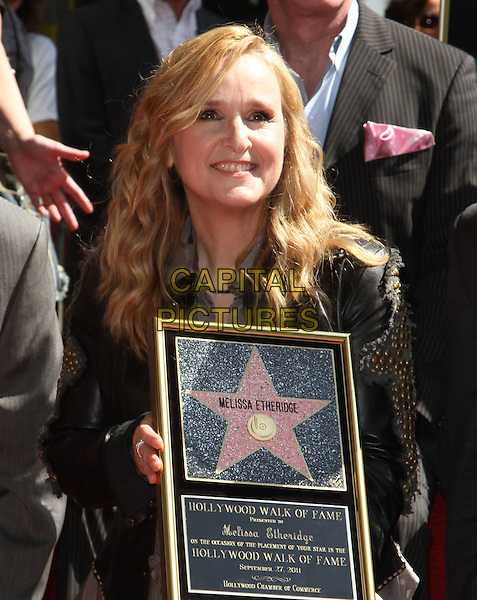 Melissa Etheridge .Melissa Etheridge Honored with a star on the Hollywood Walk of Fame  Held at On Hollywood Blvd., Hollywood, California, USA..27 September 2011 .half length black jacket leather studs studded plaque .CAP/ADM/KB.©Kevan Brooks/AdMedia/Capital Pictures.