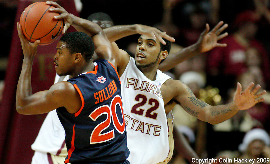 TALLAHASSEE, FL 12/11/09-FSU-AU BB09 CH36-Florida State's Derwin Kitchen, right, defends Auburn's Frankie Sullivan during second half action Thursday at the Donald L. Tucker Center in Tallahassee. The Seminoles beat the Tigers 76-72...COLIN HACKLEY PHOTO