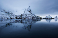 Hammarskaftet mountain peak reflecting in Reine harbor, Moskenesøy, Lofoten Islands, Norway