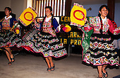 Quillabamba, Peru. Traditional dancers in traditional dress performing at a festival.