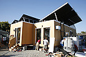 Santa Clara University students race to finish pre-contest construction of their solar home before transporting it to Washington, D.C. for the 2007 Solar Decathlon competition. Photovoltaic and hot water solar panels cover the roof.