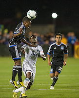 SANTA CLARA, CA - April 6, 2013: San Jose midfielder Cordell Cato (7) heads a ball during the San Jose Earthquakes vs Vancouver Whitecaps FC game at Buck Shaw Stadium in Carson, California. Final score San Jose Earthquakes 1, Vancouver Whitecaps FC 1.