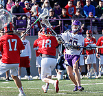 UAlbany Men's Lacrosse defeats Stony Brook on March 31 at Casey Stadium.  Kyle McClancy (#40) shoots past Harrison Matsuoka (#18) and Ryland Rees (#17).