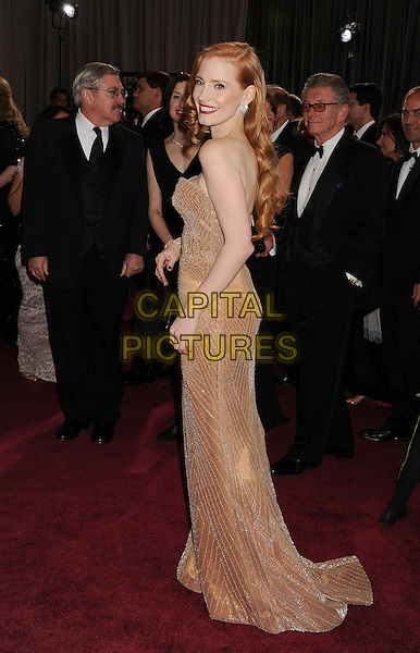 Jessica Chastain (wearing Armani Prive).85th Annual Academy Awards held at the Dolby Theatre at Hollywood & Highland Center, Hollywood, California, USA..February 24th, 2013.oscars full length blush strapless dress gown gold sparkly side .CAP/ROT/TM.©Tony Michaels/Roth Stock/Capital Pictures