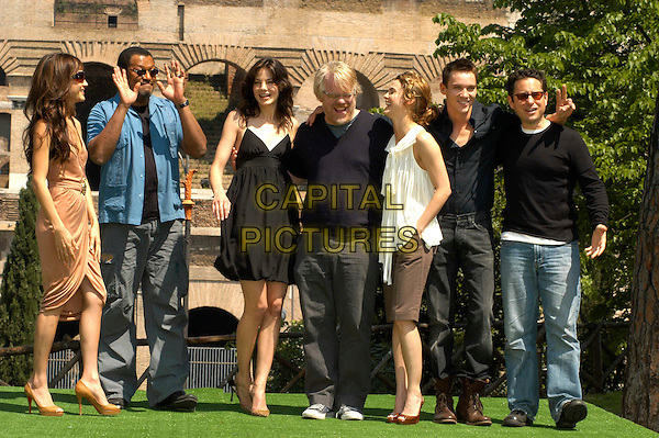 "CAST - MAGGIE Q, LAURENCE FISHBURNE, MICHELLE MONAGHAN, PHILIP SEYMOUR HOFFMAN, KERI RUSSELL, JONATHAN RHYS MEYERS & J.J. ABRAMS.Photocall for ""Mission Impossible 3"" at the Colosseum, Rome, Italy..April 24th, 2006                   .Ref: CAV.full length black dress jeans denim laughing.www.capitalpictures.com.sales@capitalpictures.com.© Capital Pictures."
