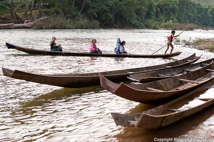 Laotians cross the Nam Ha in Luag Namtha, Laos on Novemeber 11, 2009.   (Photo by Khampha Bouaphanh)