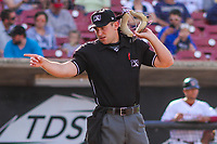 Home plate umpire Jason Johnson signals to the dugout during game one of a Midwest League doubleheader between the Wisconsin Timber Rattlers and the Kane County Cougars on June 23, 2017 at Fox Cities Stadium in Appleton, Wisconsin.  Kane County defeated Wisconsin 4-3. (Brad Krause/Four Seam Images)
